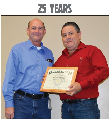 Johnny Huizar receives his certificate for 25 years with the City of Pleasnton from City Manager Bruce Pearson. Huizar is Director of Public Works.