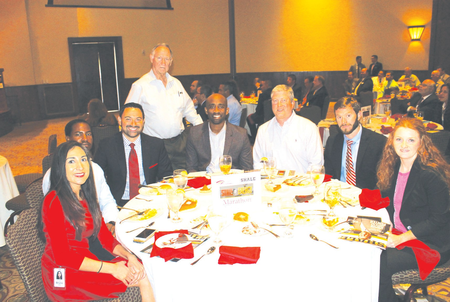 PLEASANT ON EXPRESS PHOTO Marathon Oil Corporation table at the State of Energy event. Seated, from left, are Briana Lyssy, MBA, Government and Community Affairs Liaison - Eagle Ford Asset Team; Anthony Williams – Human Resources Consultant; Eduardo Parra – Marathon Oil guest; Justin Iglehart – Facilities Engineer; David Nuckolls – HES Professional; Justin Houck – Regulatory Compliance Representative and Jinni Castañeda – Regulatory Compliance Supervisor. I was asked to sit at the Marathon table and am standing behind the Marathon group. Marathon Oil Corp. has an operations office located in Pleasanton that serves the Eagle Ford Shale.