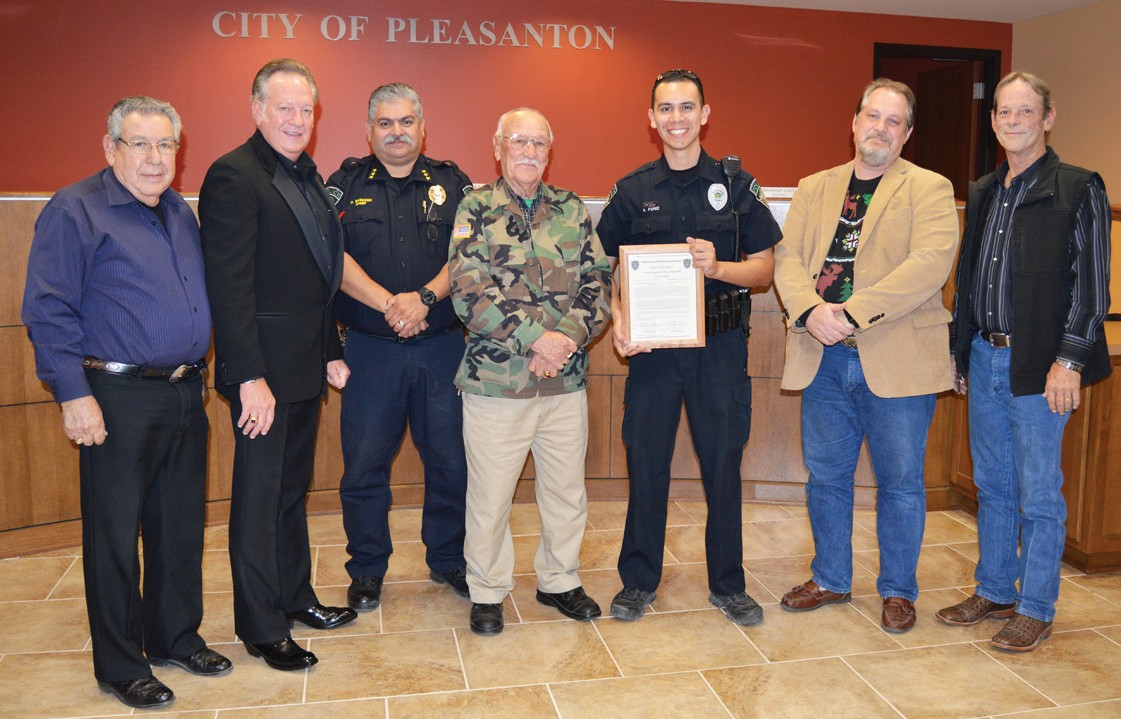 Pleasanton Police Officer Anastacio Perez (with certificate) receives an award of appreciation from the City of Pleasanton. Officer Perez circulated a video that contained the suspect and was identified by an off-duty Officer Justin Granado who was recognized at an earlier meeting. Congratulating Perez are, left to right, Eliseo Flores, District 4; Travis Hall Jr., District 6; Chief Ronald Sanchez, Abraham Saenz, District 2; Mayor Pro Tem Doug Best, District 1 and Robert Earl Wood, District 5.