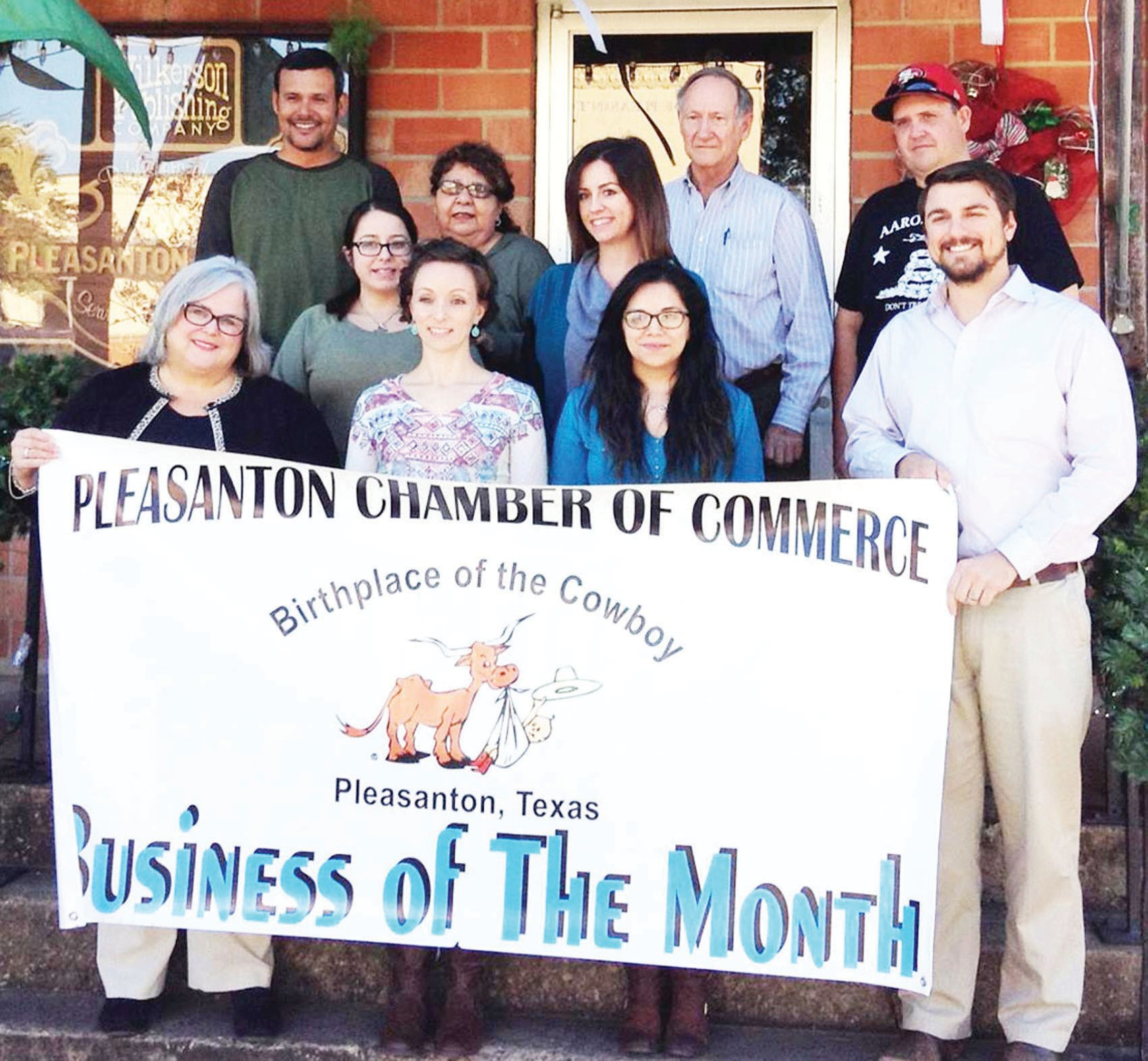 Cindy Mumm | Pleasanton Chamber of Comm erce The Pleasanton Chamber of Commerce named the Pleasanton Express as Business of the Month for January. Gathering for the presentation of the banner that will be displayed all month are some of the Express staff. Left to right, top row are Chris Filoteo, Hope Garza, Leon Zabava and Aaron Davidson. Middle row are Erika Vela and Robbie Hamby. Front row are Sue Brown, Sarah Pace, Amanda Velasquez and Pleasanton Chamber president Kevin Aniol.