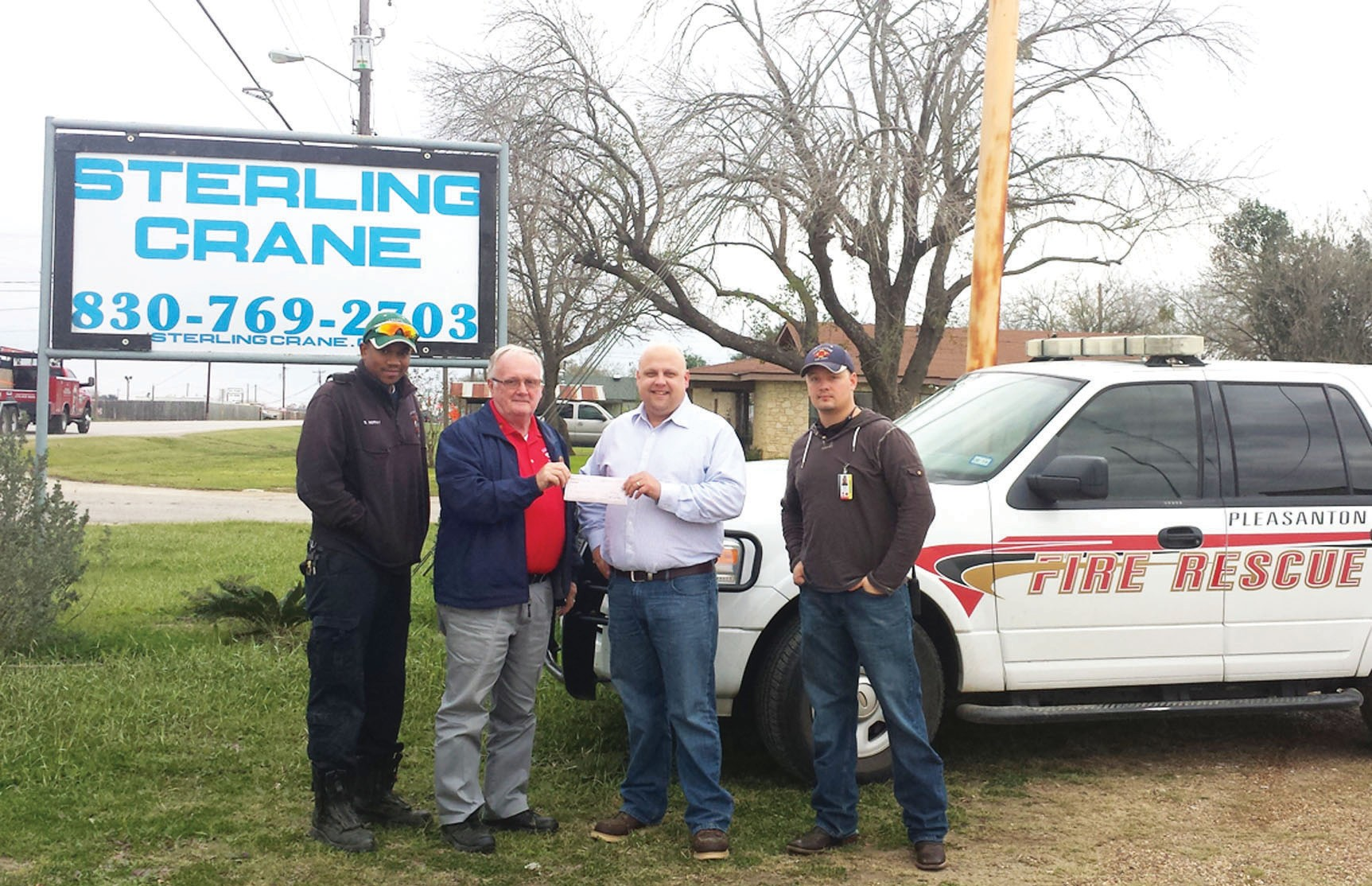 The Pleasanton Fire/Rescue Department received a donation of $500.00 from Sterling Crane. Left to right are: Lt. Sheridan Murray, Chief Chuck Garris, Sterling Branch Manager Aaron Heinze and Sterling Crane Operator/Fire Volunteer Richard Capps.