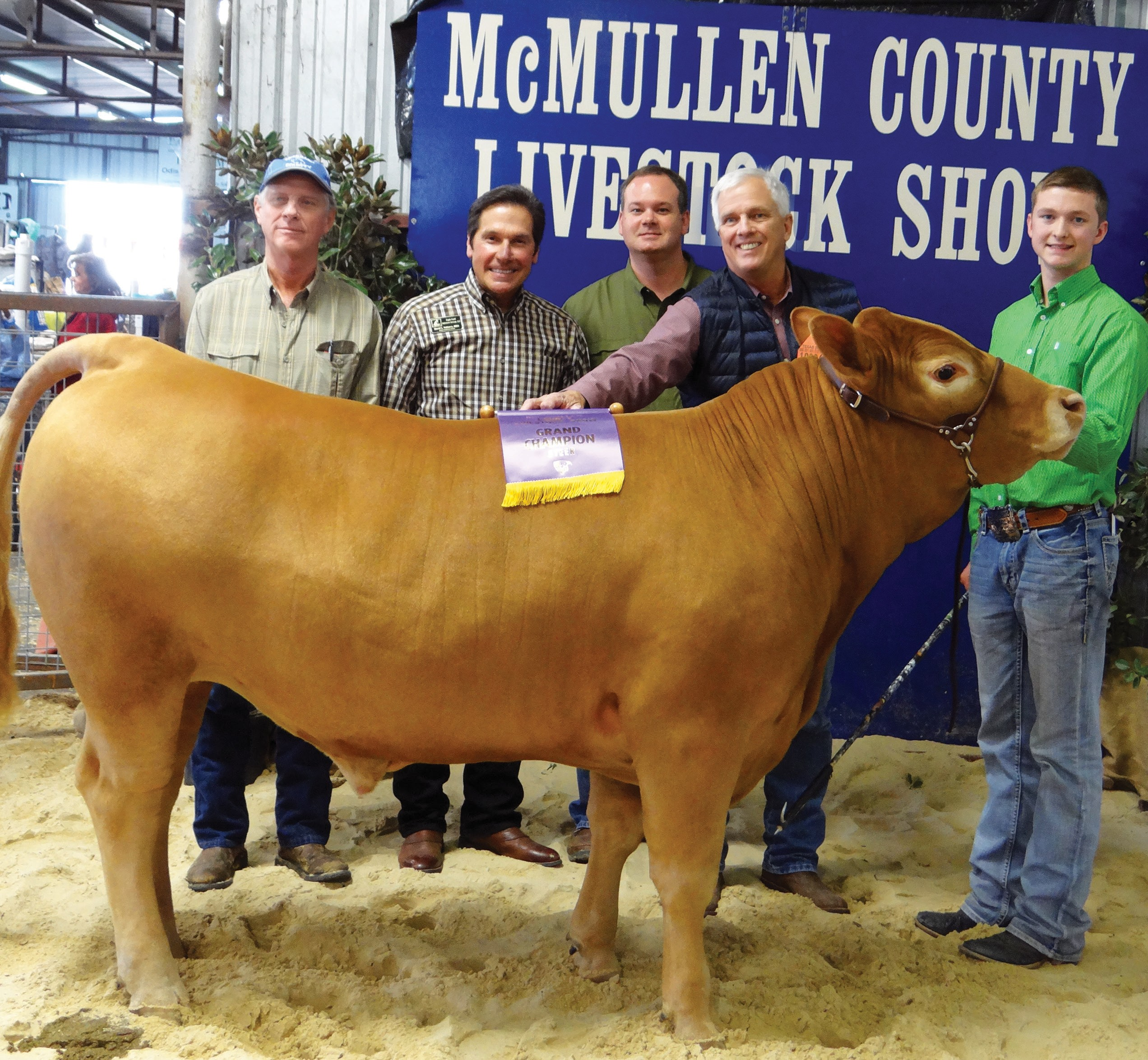 The McMullen County Livestock Show Grand Champion Steer was shown by Colton McCartney. The steer was purchased for $12,000. Buyers include, left to right, Marty Harris, San Miguel Syndicate; Dave Valtiera, Atascosa Syndicate; Dave Underwood, School House Syndicate and Walt Franklin, Atascosa Syndicate. Not pictured is Jim Wheeler, Atascosa County Livestock Exchange