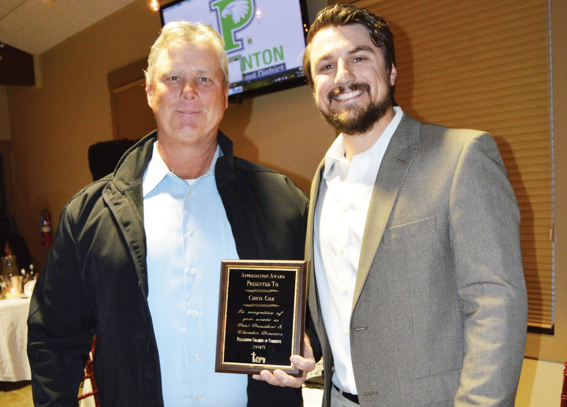 Pleasanton Chamber of Commerce past president Chico Cox receives his plaque of appreciation for his fours years of office from current president Kevin Aniol.