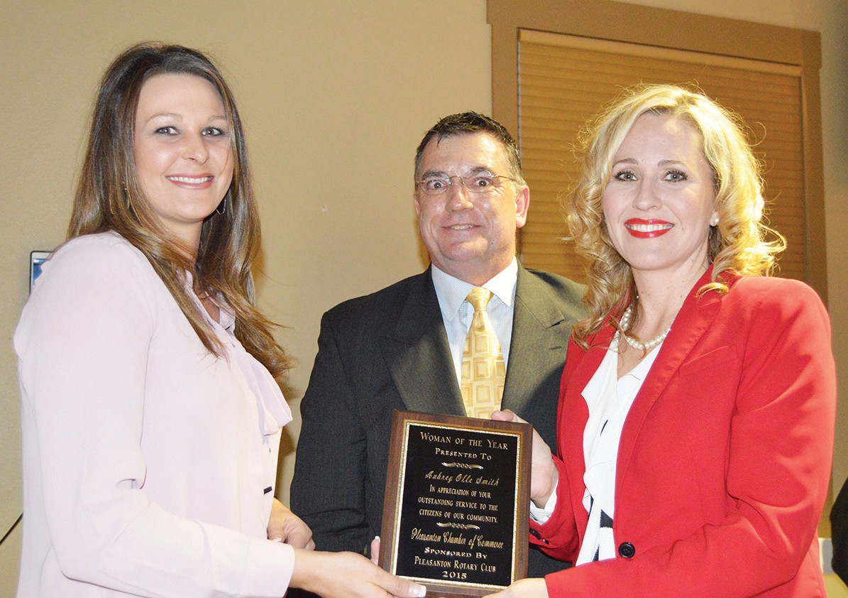 Aubrey Smith (right) was named Woman of the Year at the Pleasanton Chamber of Commerce banquet. She received her award from the Pleasanton Rotary President Rusty Garvin (center). Helping to present is Jessica Wier, chamber director (left).