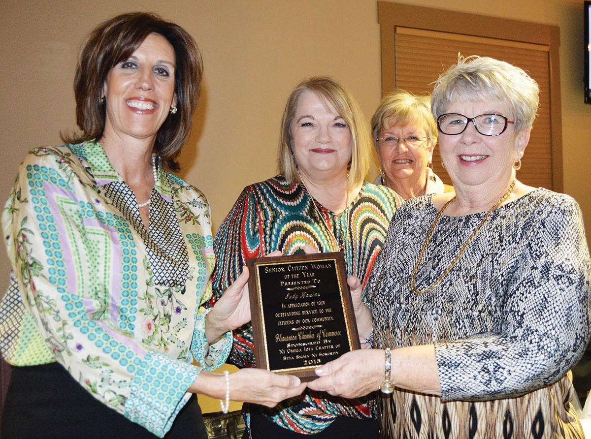 Senior Citizen Woman of the Year Judy Havins (right)receives her award from Pat Seay Cox, Chamber director/secretary (left)and plaque sponsor Xi Omega Iota Chapter of Beta Sigma Xi Sorority members Jolene Disbro and Sudie Halpin (center)