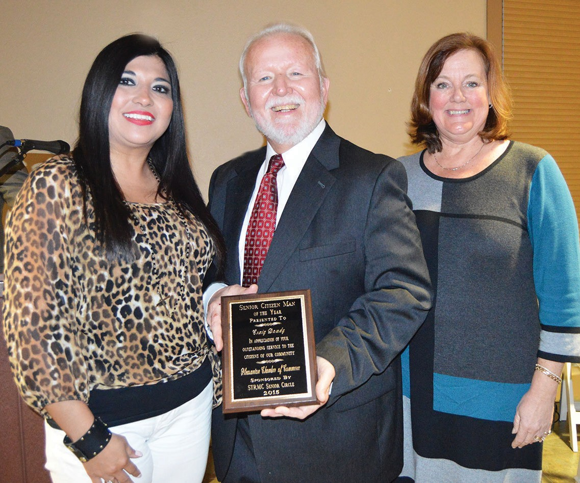 Senior Citizen Man of the Year, Craig Dowdy, (center) received his award from Leslie Ricks,(right) STRMC Senior Circle representative at the annual chamber banquet. Chamber treasurer, Jackie Brown, assisted.