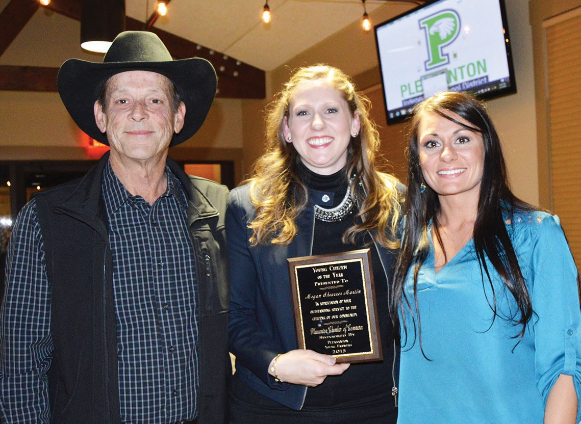 Pleasanton Young Farmers member Robert Earl Wood (right) presented the Young Citizen of the Year award to Megan Shearrer Martin. Chamber director Tiffiney Willmon assisted with the presentation.