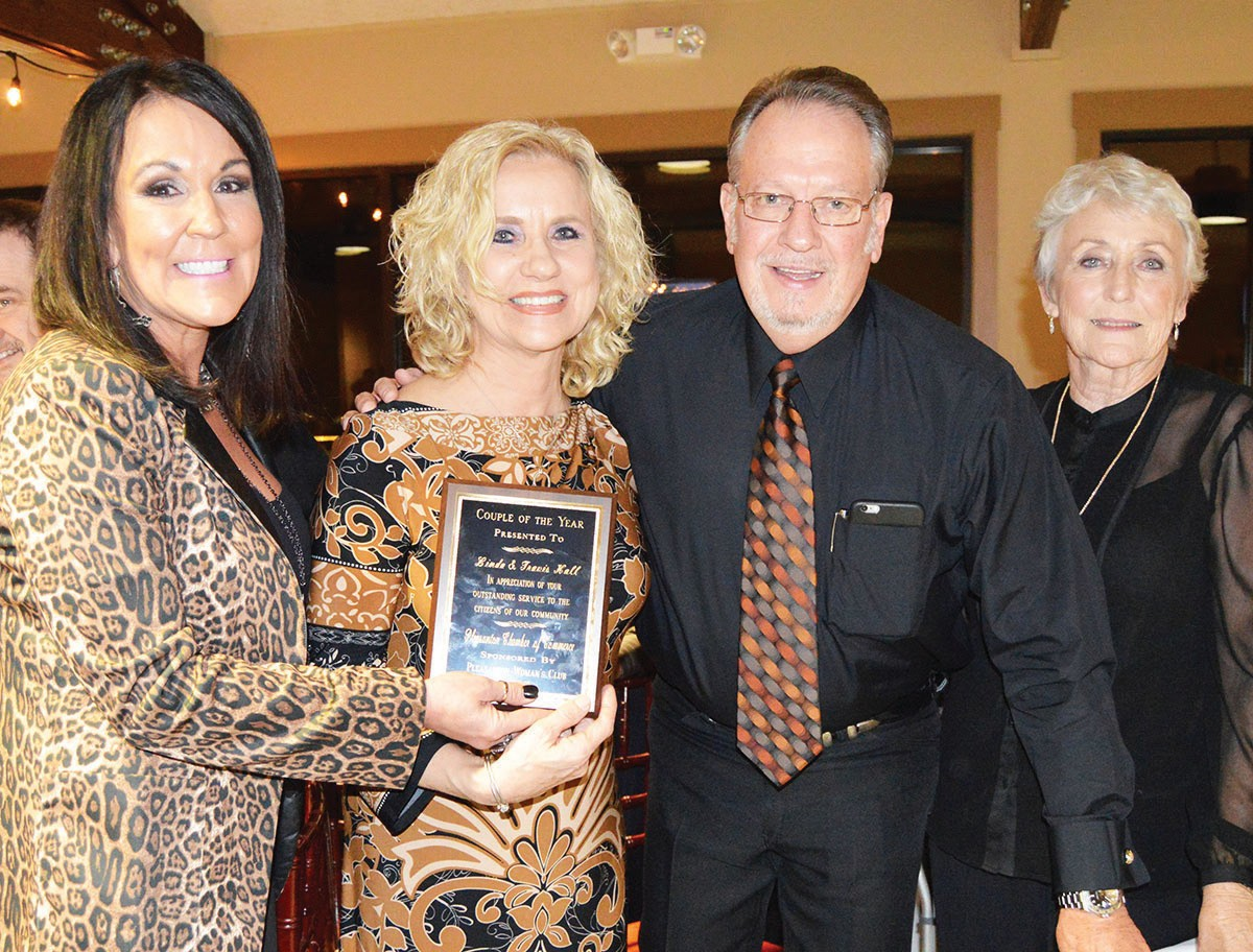 Receiving the Couple of the Year award were Linda and Travis Hall (center). The presentation was made by Patsy Troell, (right)Woman's Club past president and sponsor of the award. Chamber director Lisa McAskill (left)assisted.