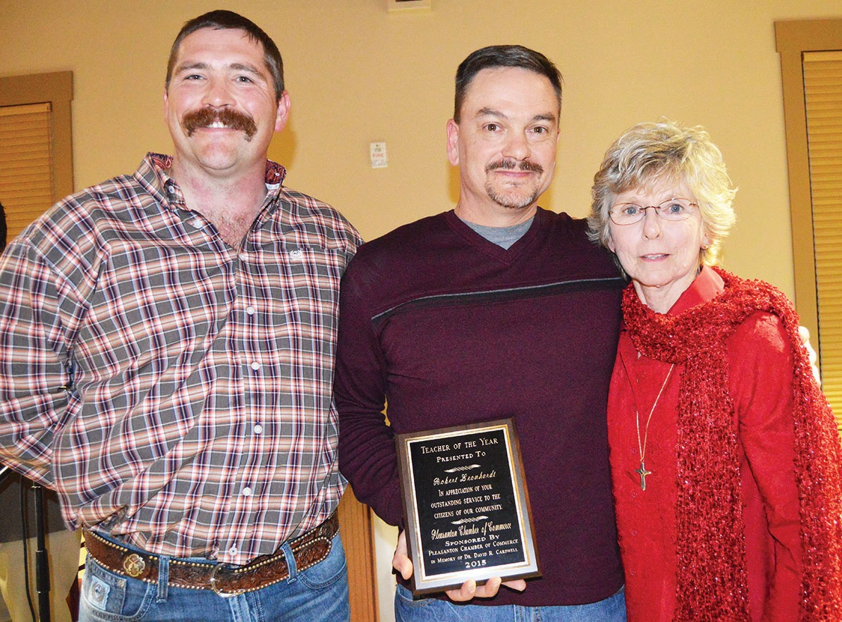 Presenting the Teacher of the Year - In Memory of Dr. David R. Cardwellaward to Robert Leonhardt was Sandy Coward (right). Sponsoring the award was Pleasanton Chamber of Commerce and was assisted by director Gaylon Andrews.