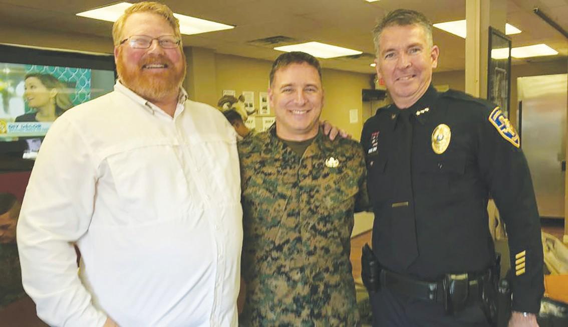 Scotty Smith, Cowboy Fellowship Associate Pastor, SSgt. Phillip McGill and Jourdanton Police Chief Eric Kaiser.