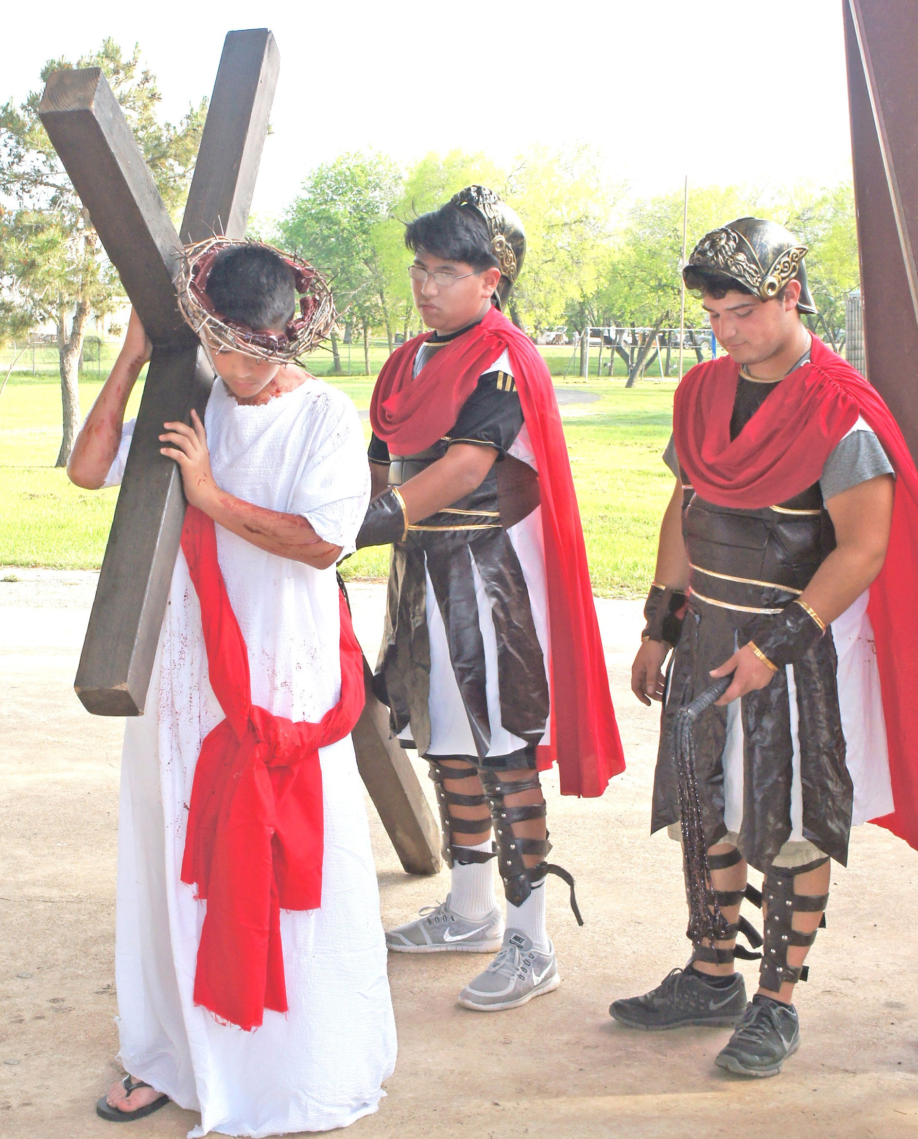On Friday, March 18, the youth of St. Matthew Catholic Church in Jourdanton presented the Live Stations of the Cross. Many gathered at the Jourdanton City Park to take part in this spiritual presentation. Pictured are: Joseph Gonzales portraying Jesus, as he is beaten by Roman soldiers, played by Emmanuel Lugo and Jesse Ledesma.