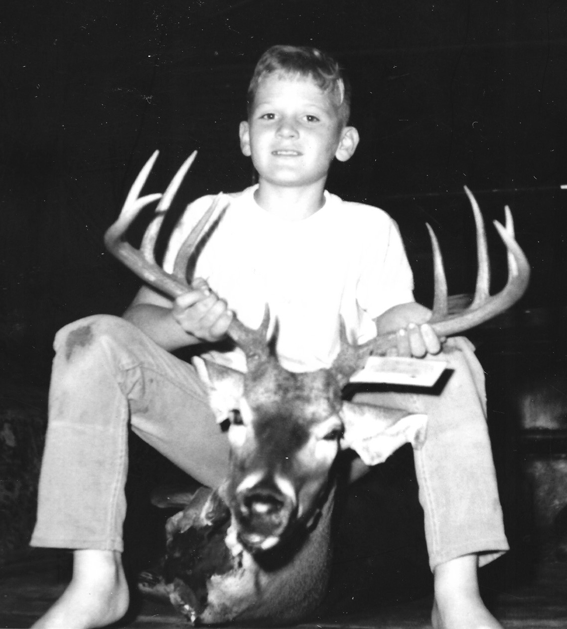 Randy, 9, with a 10-point buck with a 20-inch spread.