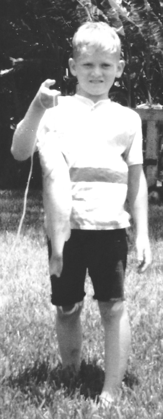 Randy Shearrer, age 9, in July, 1968 with a two and a half-pound bass he caught at the Perry Dairy on Crain Road east of Cockrell Canyon.