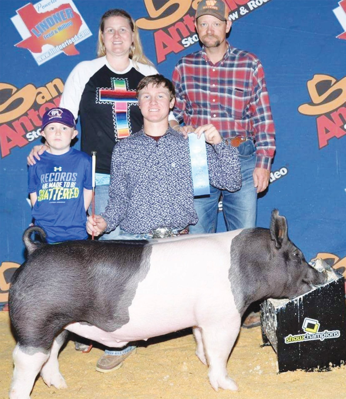 Tyler Pearson Junior at Jourdanton HS placed 1st in his dark cross class at the San Antonio Livestock Show. Pictured with Tyler are his parents Bud and Amy Kielman and brother Wade