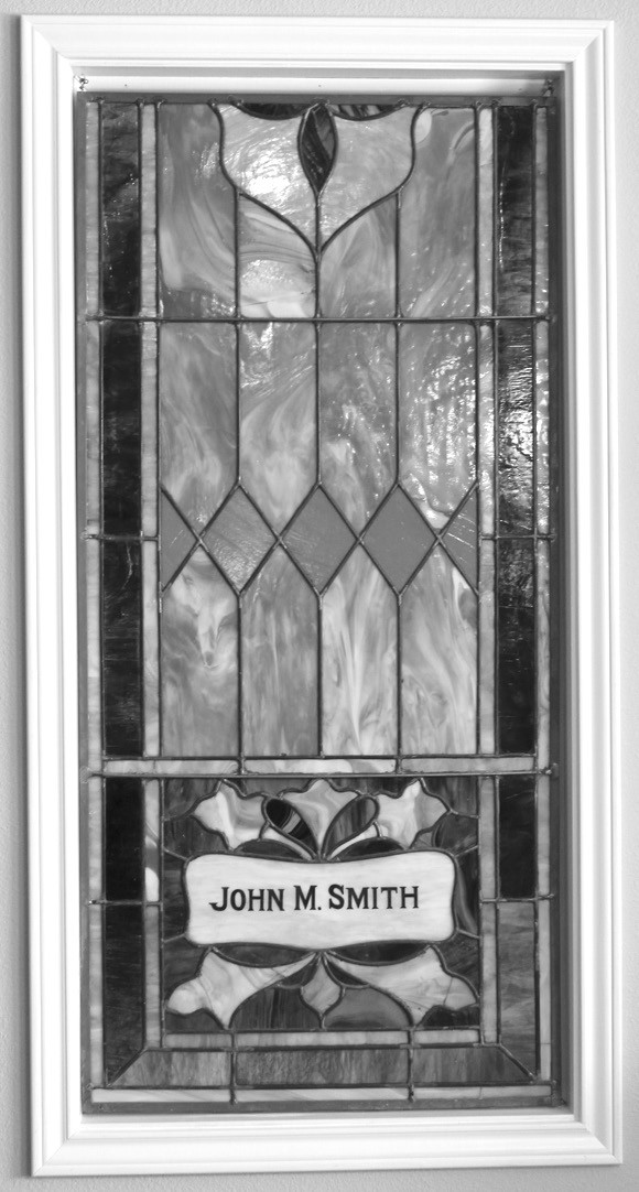 This stained glass window was placed in the old Methodist Church in Pleasanton, in the early 1900s, in honor of John M. Smith.