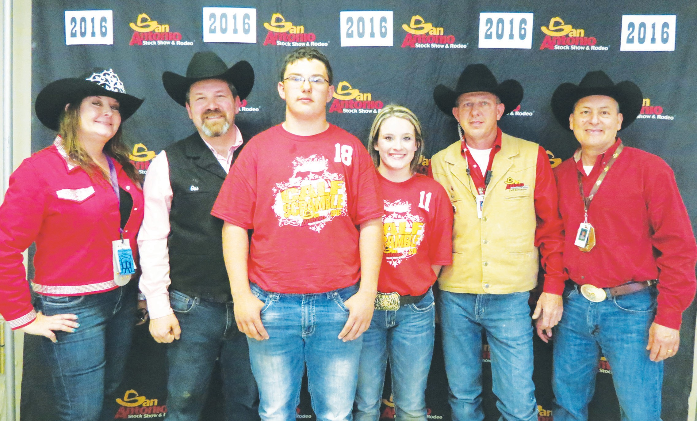 Poteet FFA members Sammy Ritchey, sophomore and Ruby Jo Peoples, junior caught the $1000.00 certificate at the San Antonio Livestock Show Calf Scramble. Pictured along with Sammy and Ruby are members of S.A.L.E.