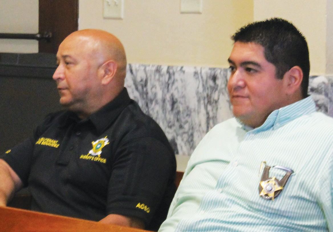 From left, are Lt. Mike Benavidez and Capt. Martin Gonzales, representing the Atascosa County Sheriff's Dept. that was recognized by the Texas Commission of Jail Standards for excellent work whereby the department was recipient of a Certificate of Compliance. Recognition was during the Commissioners' Court meeting, Monday, March 28.