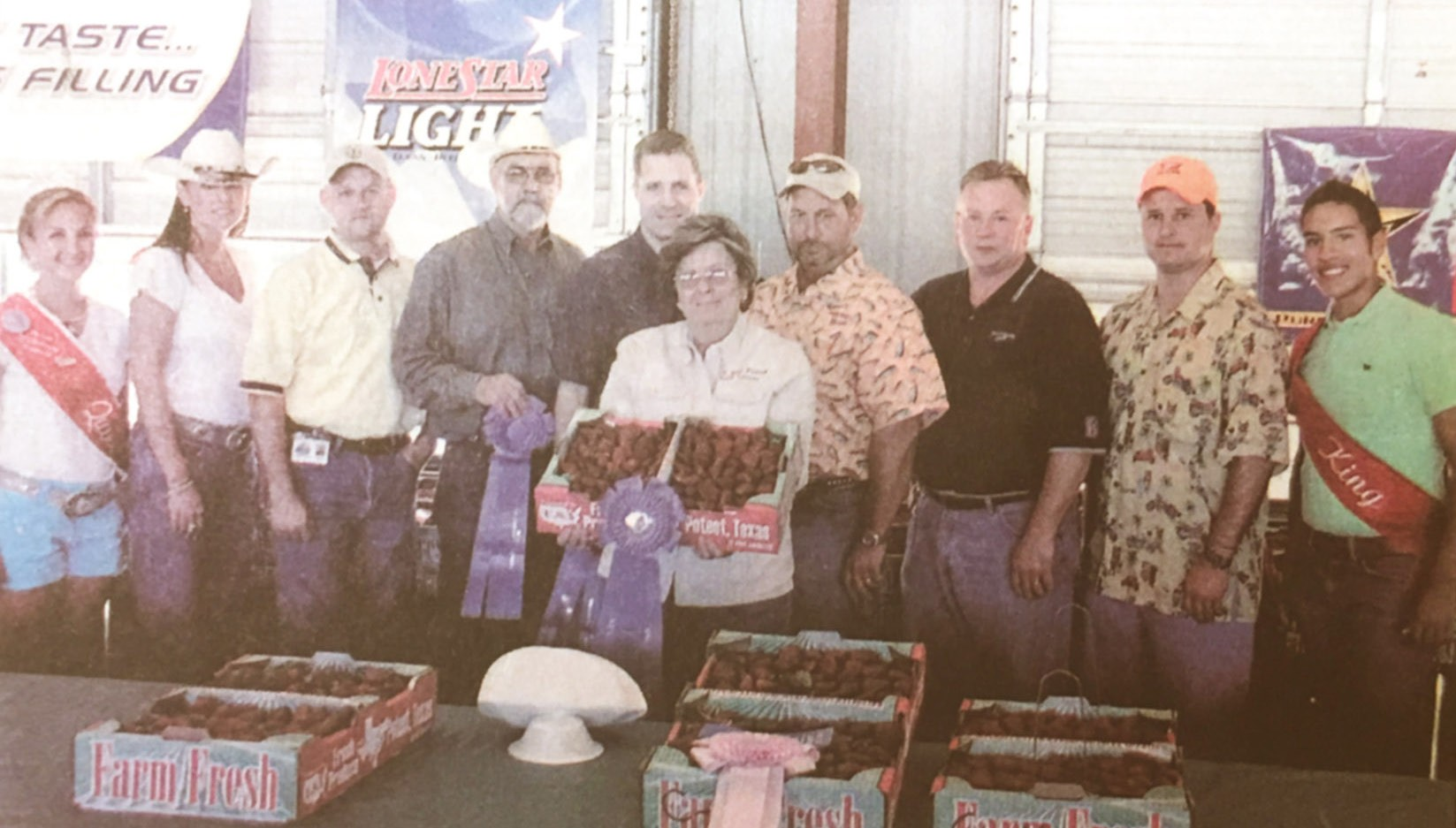 Pictured in her first win - which also happened to be Sweepstake winning Grand and Reserve Grand Champion Strawberries - are Cora (with berries) and left to right, Queen Leata Martinez, Kara Bailey (Lone Star Light), Thomas Johnson (Halo Distributing), Donald Retzloff (American Electric Power), Cory Oiver (H-E-B), Mark Biediger (Pure Party Ice), Jerry Brown (Budweiser), Kenny Stewart (Halo Distributing) and King Jake Olivares.