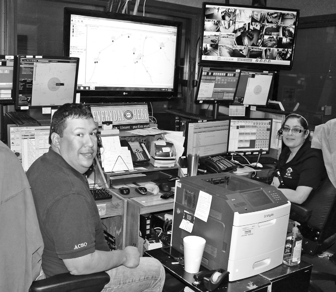 Seated in the Atascosa County Sheriff's Dept. Dispatch Room are Andrew Guerra and Veronica Medina.