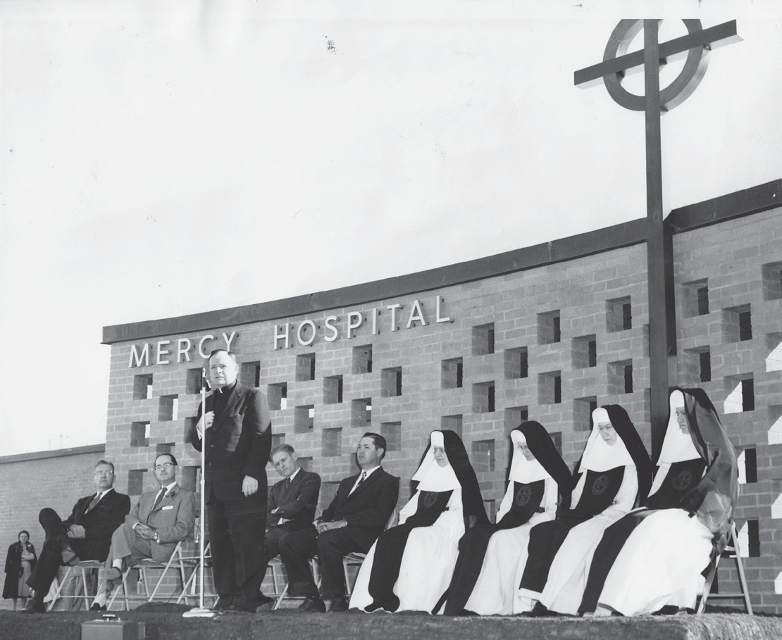 The opening ceremonies for Mercy Hospital featured speeches by Dr. U. B. Ogden (seated second from left) and Leon Steinle (seated fourth from left). The Sisters of the Blessed Sacrament and Incarnate Word of Victoria would manage the new hospital for almost 50 years.