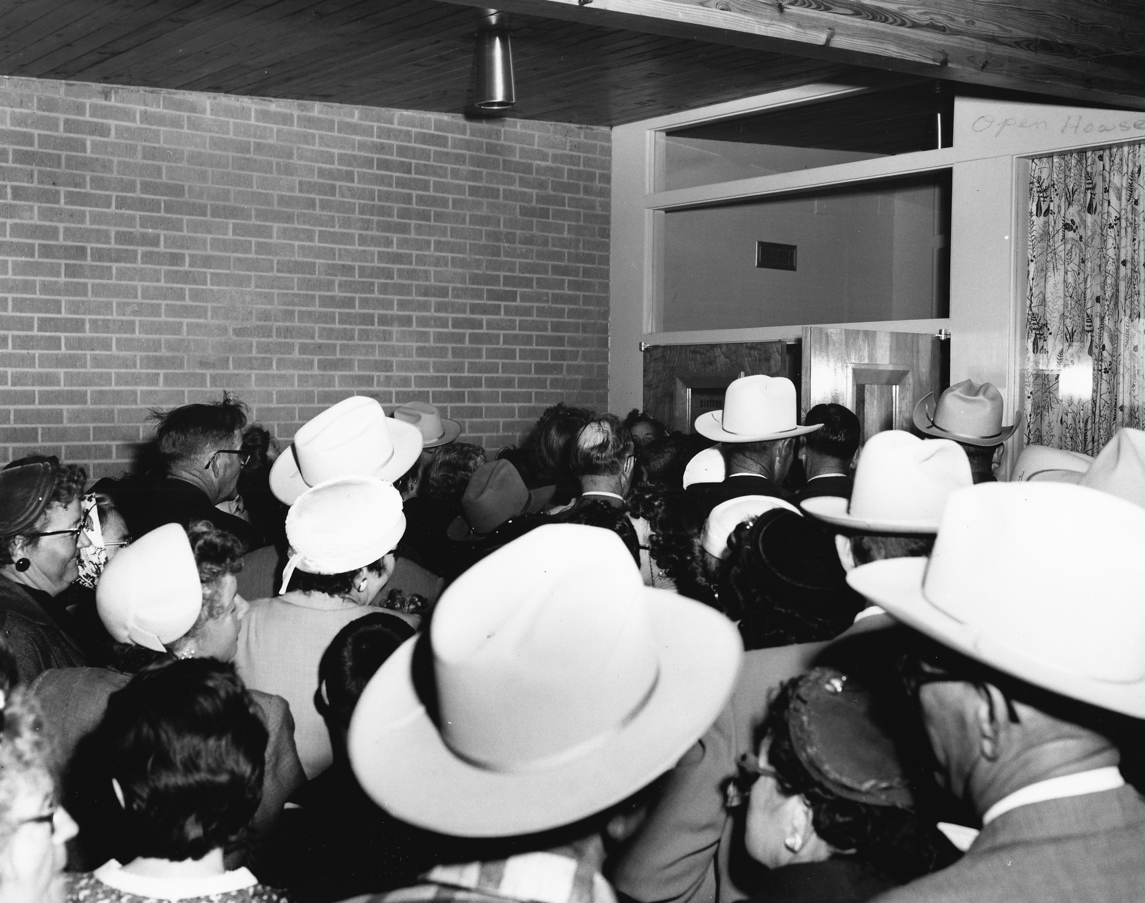 Visitors crowd the front door at the brand new Mercy Hospital grand opening in 1956. The first patient was admitted January 7, 1957.