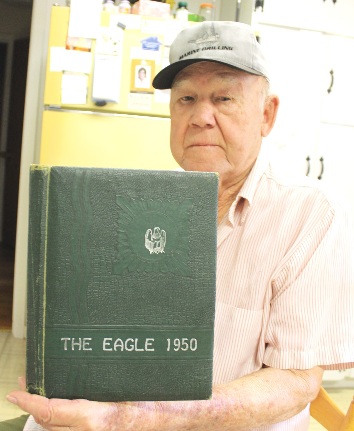 Marvin Deckert with his 1950 Pleasanton Schools annual.