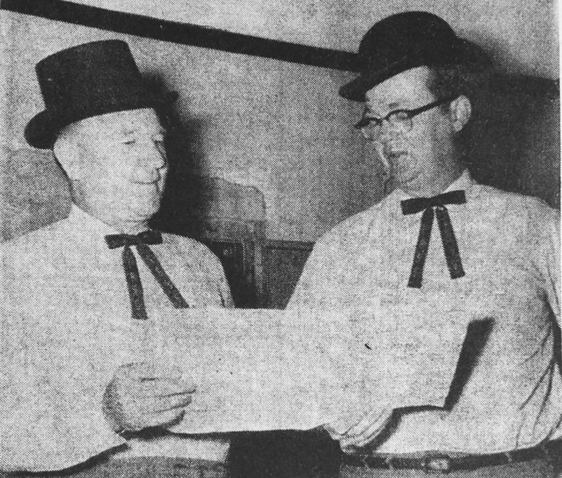 Centennial Lochinvars-Duded up in centennial hats are Cecil Smith, left, and Taylor Brite, high moguls of the coming Atascosa County Centennial Brite is county centennial chairman and Smith is his No. 1 assistant. Hats such as these and other centennial novelties will be put on sale soon. Express photo originally ran in the May 17, 1956 edition of the Express.