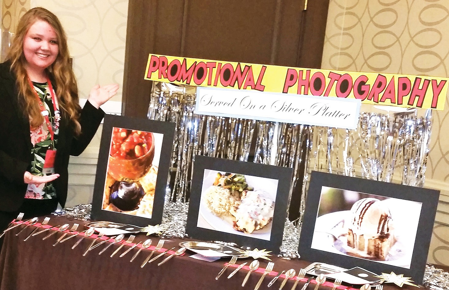 Alyssa Dickson showcases her photography skills, placing 2nd in Promotional Photography at the National Leadership Conference in Boston, Mass. (Photos were taken of food prepared by Lew's.)