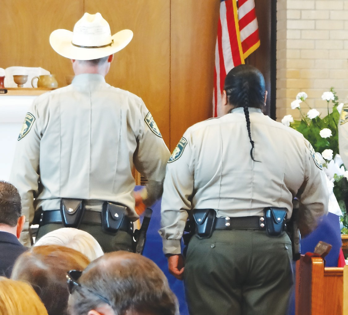Two McMullen deputies at the casket of John Eric Rutherford.