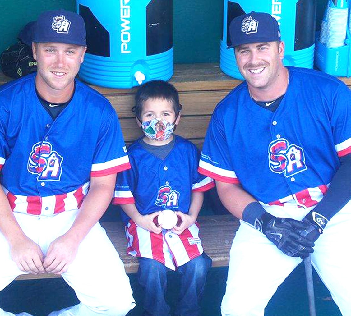 Chapa sits with SA Missions infielders, Taylor Lindsey and Mike Olt, during Saturday night's game.