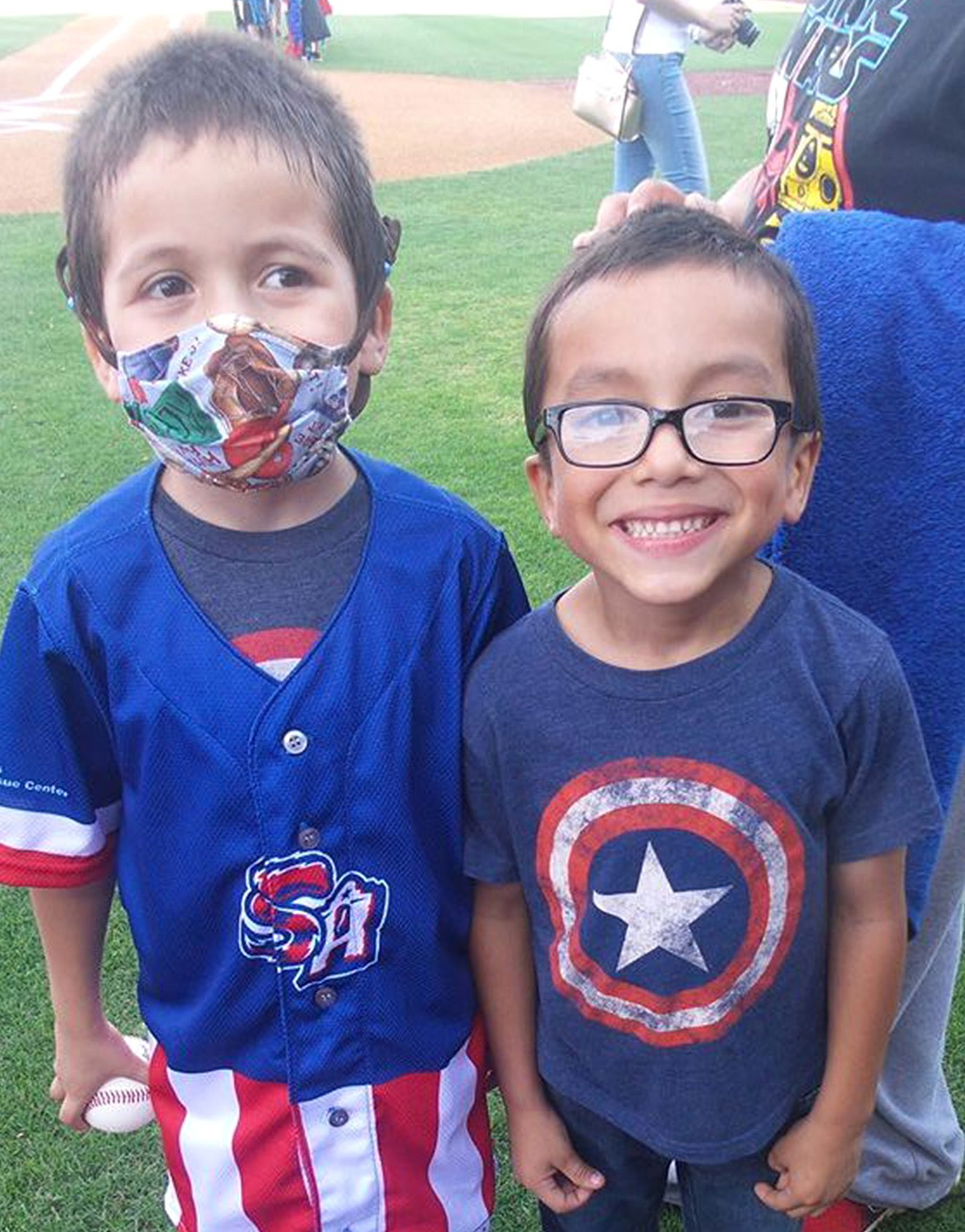 Twin brothers Darian and Jayden Chapa smile proudly after Darian received a team jersey at the San Antonio Missions game on Saturday, May 14.