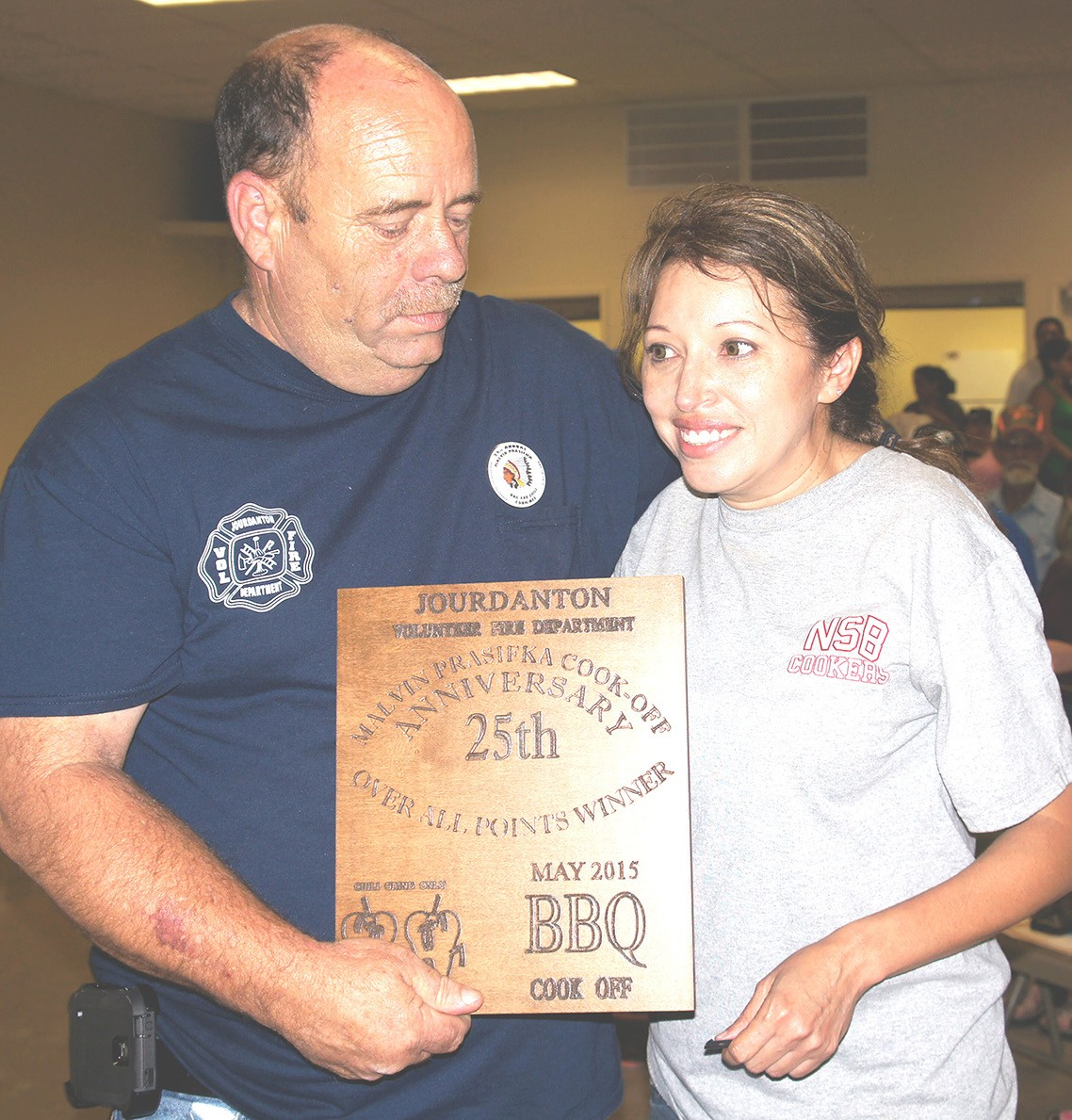 David Prasifka presents a plaque to Jackie Milligan, the overall winner at the 2015 Jourdanton Volunteer Fire Department Malvin Prasifka BBQ and Chili Cook-Off. Be sure to make plans to attend this year's cook-off this Friday through Sunday, May 20-22 at the American Legion Hall.