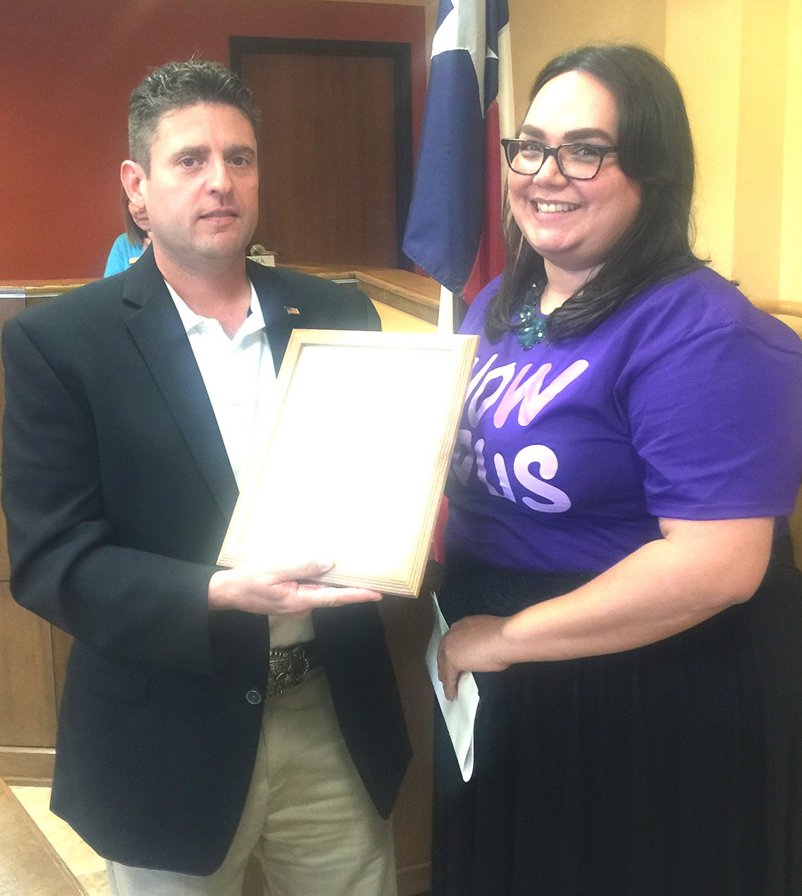 "Pleasanton Mayor Clint Powell proclaims the month of May as Lupus Awareness month and May 20, 2016 as ""Wear Purple Day"" with South Central Texas' Lone Star Lupus Field Services Director Angelica Garza at the May 5 meeting."