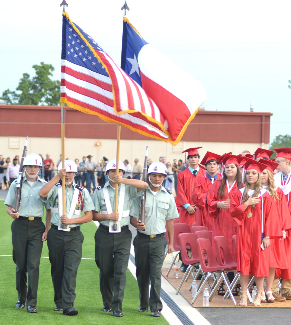 2016 Seniors rise as the Color Guard passes and the commencement ceremonies begin.