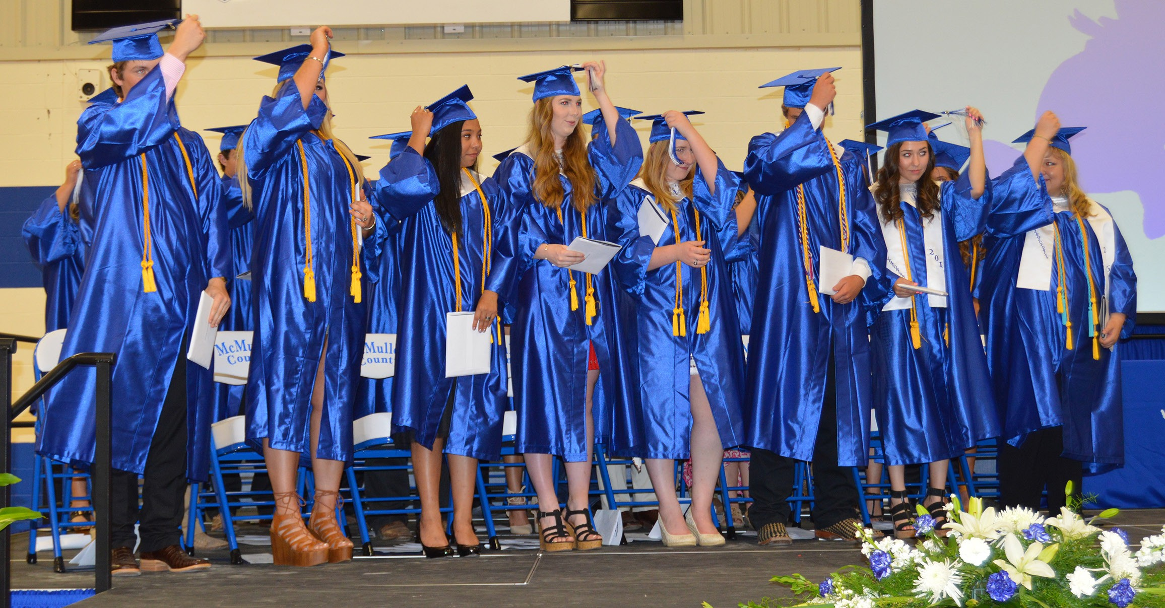 The McMullen County HIgh School Senior Class turn their tassels after Superintendent Dave Underwood certified they were all 2016 graduates during the commencement ceremony held Saturday, May 28 in the new Cowboy Gymnasium. The 24 graduates also received over $645,000 in scholarship funds.