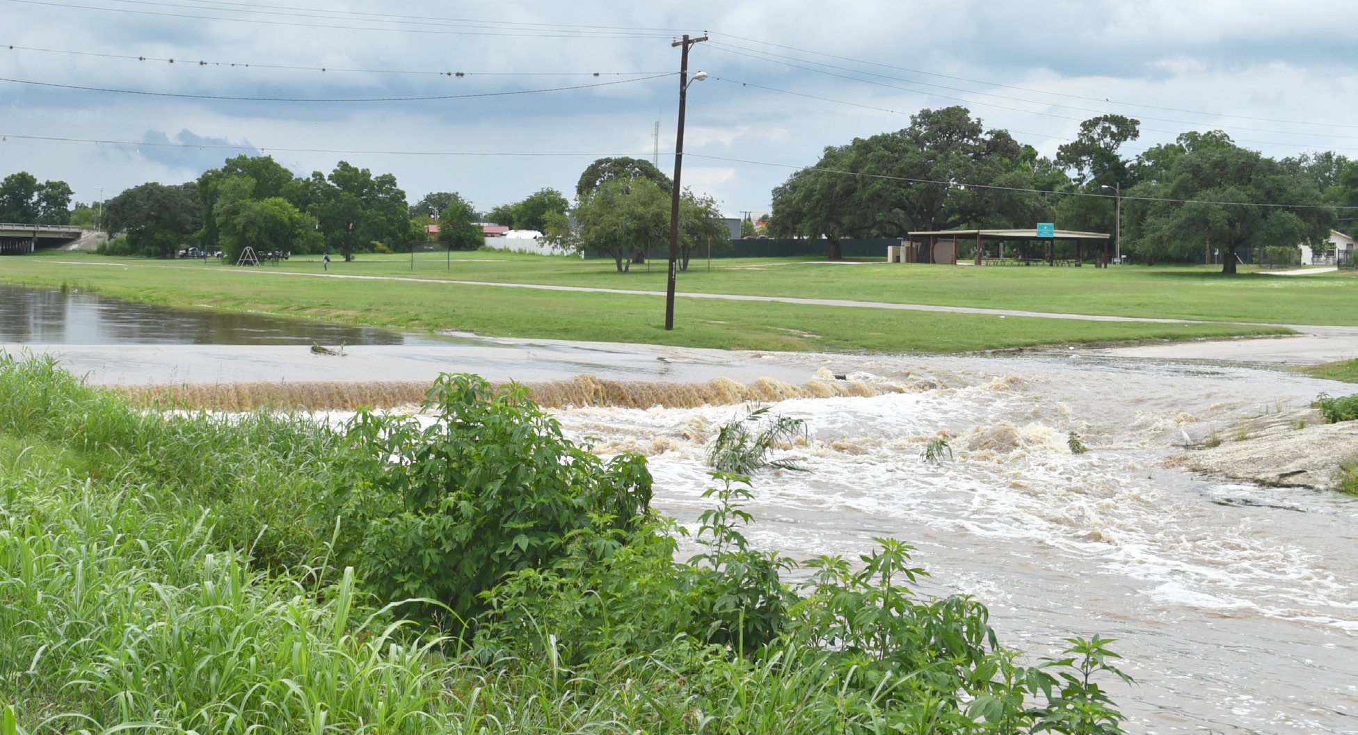 The Atascosa River rages over the bridge at Hunt Street in Pleasanton after several inches of rain fell last week.