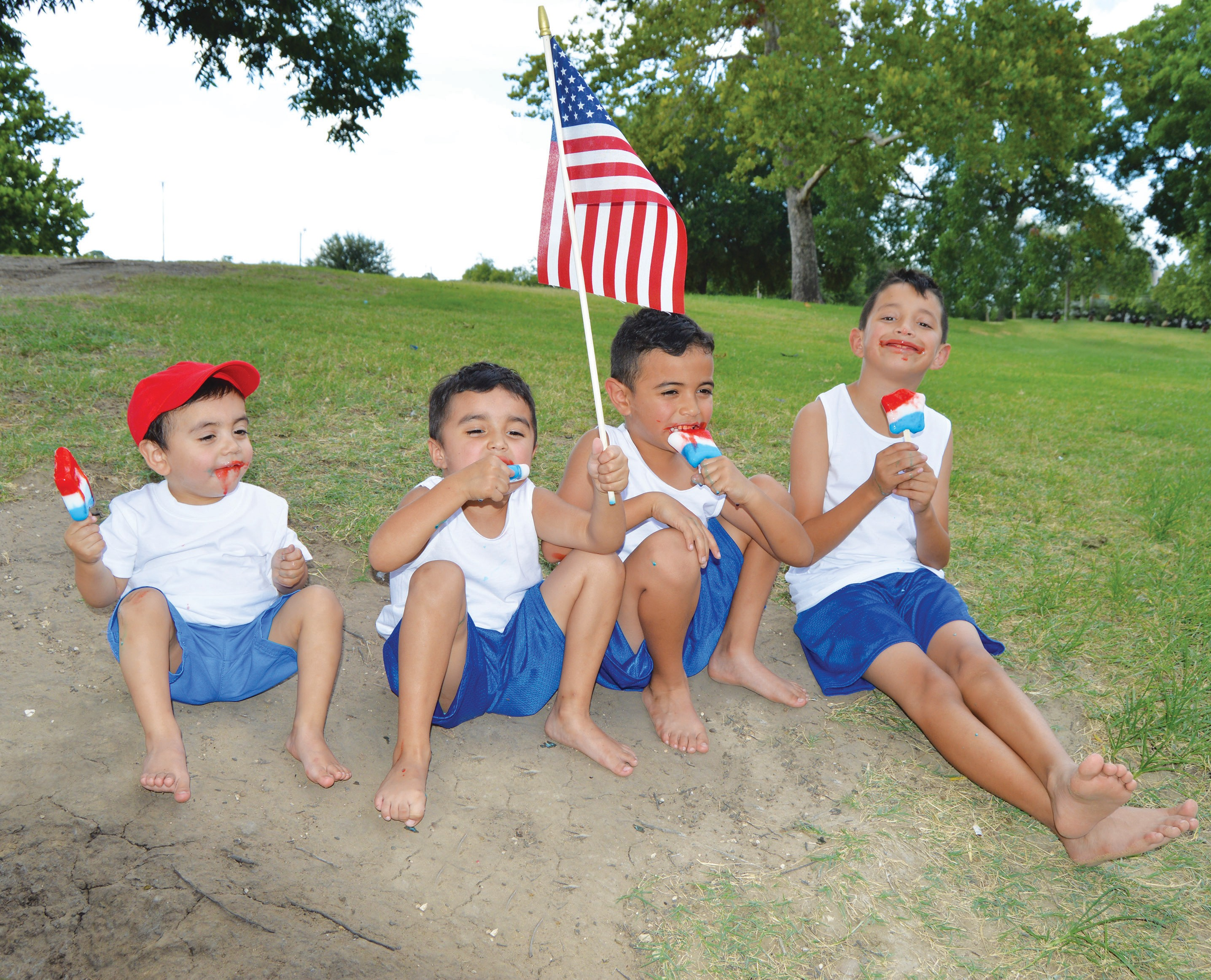 The Velasquez boys, Silas, K.C., Elijah and Zaiden gear up for Independence Day festivities by enjoying red, white and blue Starkisses from Dairy Queen at the Atascosa County River Park. Of course, the American flag was included!