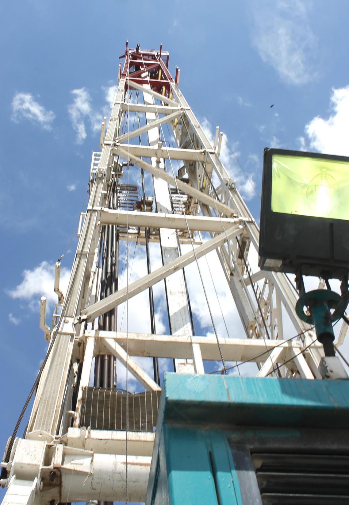 Skyward view of Trinidad Drilling Rig 123E derrick at Abraxas Petroleum Austin Chalk horizontal site south of Pleasanton.